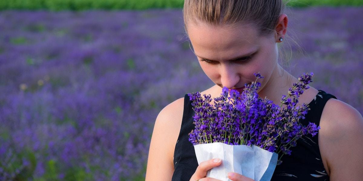 Woman smelling lavendar