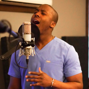 Take in this orthopedic surgeon's singing to lift your spirits
