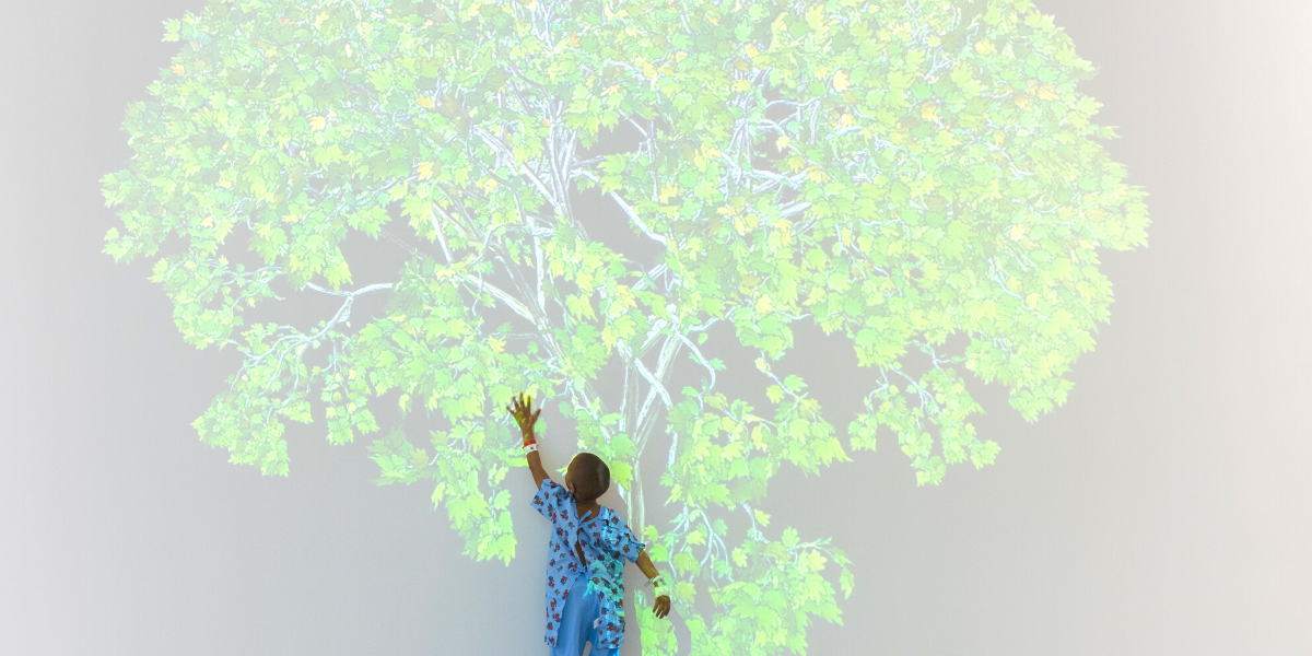 Child patient reaching for tree art